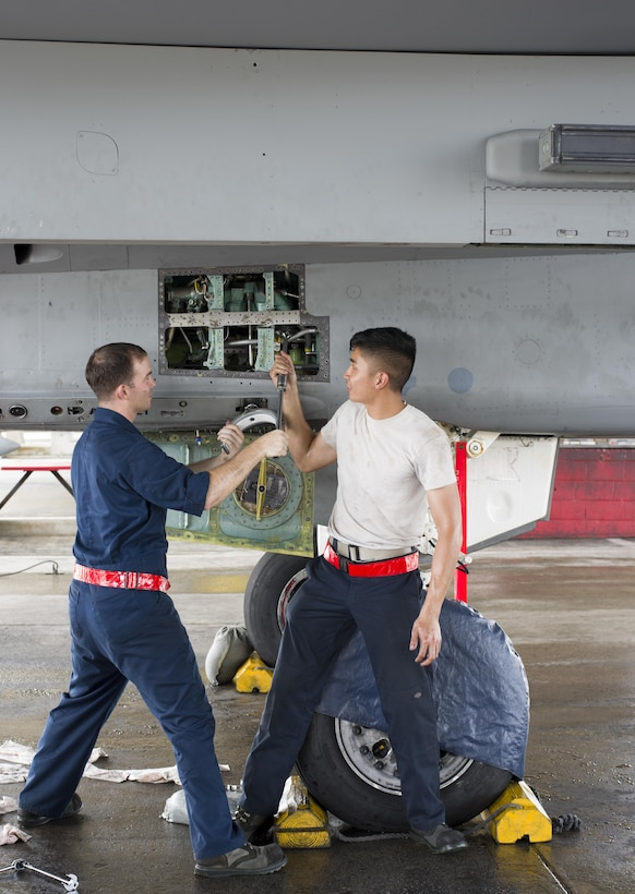 U.S. Air Force Staff Sgt. Dennis Franco and Senior Airman Devin Arden, 67th Aircraft Maintenance Unit F-15 Eagle dedicated crew chiefs, perform maintenance on hydraulic systems of an F-15 June 13, 2017, at Kadena Air Base, Japan. The Eagle's air superiority is achieved through a mixture of unprecedented maneuverability and acceleration, range, weapons and avionics. (U.S. Air Force photo by Senior Airman Omari Bernard)