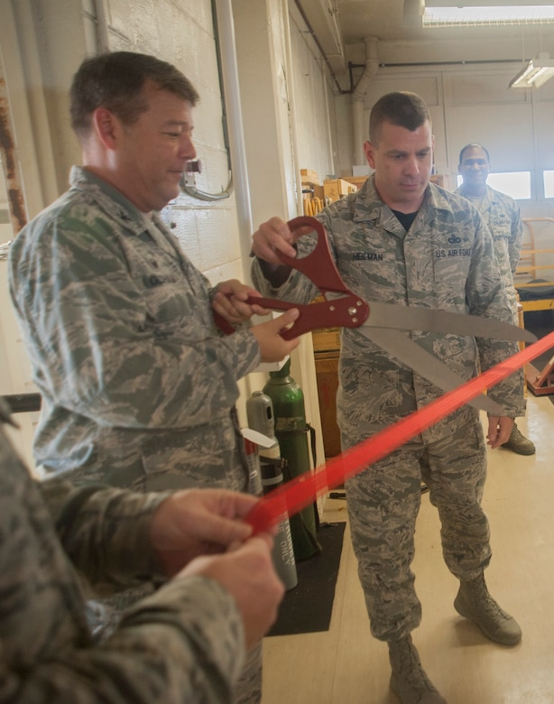 U.S. Air Force Col. Paul Oldham, 18th Mission Support Group commander, and Chief Master Sgt. Jason Heilman, 18th MSG command chief, cut a ribbon to signify the opening of the Air Force's only operational cryogenic production plant June 16, 2017, at Kadena Air Base, Japan. Cryogenics technicians work with oxygen and nitrogen in support of more than 30 units on Kadena that utilize cryogenic assets. (U.S. Air Force photo by Senior Airman Quay Drawdy)