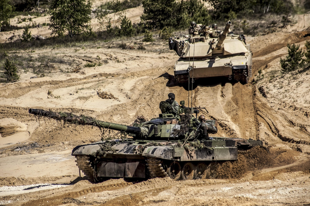Polish soldiers and U.S. Marines operate tanks during a combined arms live-fire training event at the Adazi training grounds in Latvia, June 9, 2017, as part of Saber Strike, an annual exercise in the Baltic region and Poland. Marine Corps photo by 1st Lt. Kristine Racicot