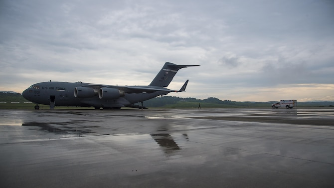 A C-17 Globemaster III sits on the Aomori Airport runway during an aeromedical evacuation in Aomori, Japan, June 15, 2017. Once the C-17 landed, a neonatal intensive care unit team from the U.S. Navy hospital, Okinawa, Japan, joined 35th Medical Group personnel to prepare the newborn for the flight. (U.S. Air Force photo by Senior Airman Deana Heitzman)