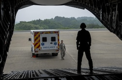 An Airman assigned to the 18th Medical Group from Kadena Air Base, Japan, assists with an aeromedical evacuation in Aomori, Japan, June 15, 2017. Since the Misawa Air Base runway remains closed for construction, the 35th Medical Group relied on solidified friendships among the Japanese community to help coordinate the evacuation at the Aomori Airport. (U.S. Air Force photo by Senior Airman Deana Heitzman)