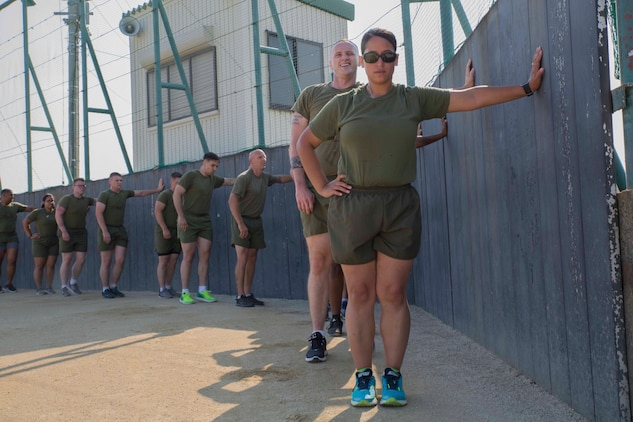 U.S. Marines wait for instruction during a Fitness Road Show at Marine Corps Air Station Iwakuni, Japan, June 14, 2017. Instructors with Force Fitness Division from Quantico, Va. visited MCAS Iwakuni as part of the road show to critique force-fitness instructors' coaching and course and to answer any questions the teachers and students had. Force Fitness Instruction is a course intended to help Marines improve their fitness. (U.S. Marine Corps photo by Lance Cpl. Gabriela Garcia-Herrera)