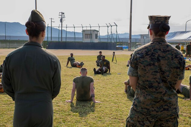 U.S. Marine Corps Staff Sgt. Charles London, lead force-fitness instructor for Marine Corps Air Station Iwakuni, shows his Marines how to foam roll their hamstring during a Fitness Road Show at MCAS Iwakuni, Japan, June 14, 2017. Instructors with Force Fitness Division from Quantico, Va. visited MCAS Iwakuni as part of the road show to critique force-fitness instructors' coaching and to answer any questions the teachers and students had. Force Fitness Instruction is a course intended to help Marines improve their fitness. (U.S. Marine Corps photo by Lance Cpl. Gabriela Garcia-Herrera)