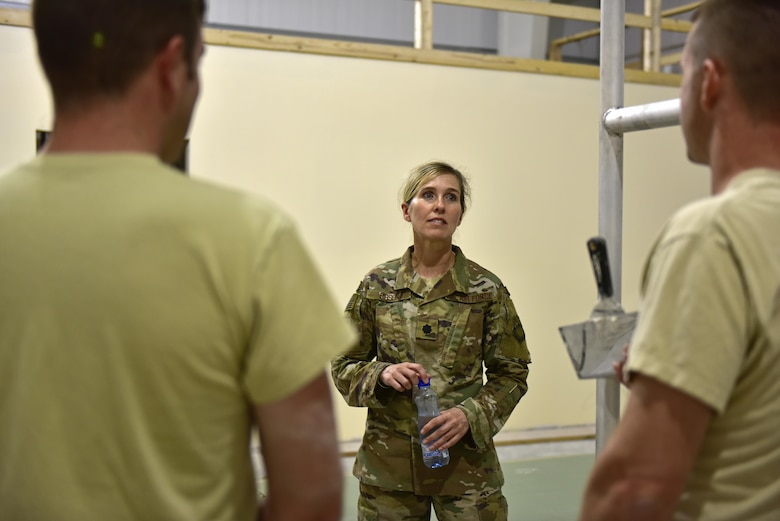 Lt. Col Heidi Gibson (middle), 407th Expeditionary Civil Engineer Squadron commander, discusses the progression of a construction project with Tech. Sgt. Mark Ricketts, 407th ECES structures assistant NCO in charge, and Staff Sgt. Troy Schneider, structural craftsman, June 7, 2017, at the 407th Air Expeditionary Group in Southwest Asia. Gibson administers to more than 260 Total Force Airmen. Their objectives are to sustain the base infrastructure and to initiate actions for future contingencies.(U.S. Air force photo by Senior Airman Ramon A. Adelan)