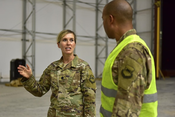Lt. Col. Heidi Gibson, 407th Expeditionary Civil Engineer Squadron commander, speaks to Senior Master Sgt. Malcom Summers, 407th ECES heavy repair superintendent, about the current progress of a construction project June 7, 2017, at the 407th Air Expeditionary Group in Southwest Asia. Gibson administers to more than 260 Total Force Airmen. Their objectives are to sustain the base infrastructure and to initiate actions for future contingencies.(U.S. Air force photo by Senior Airman Ramon A. Adelan)