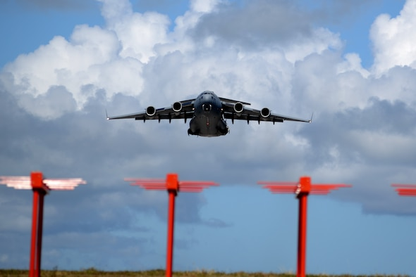 A U.S. Air Force C-17 Globemaster III aircraft assigned to Travis Air Force Base, Ca., takes off June 6, 2017, from Andersen Air Force Base, Guam. The 734th Air Mobility Squadron recently used the C-17s for a readiness exercise testing fall rescue procedures. (U.S. Air Force photo by Airman 1st Class Gerald R. Willis)