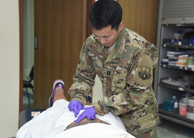 Capt. Grant Tong, the 386th Expeditionary Medical Group physical therapy element chief, conducts dry needling treatment on a patient during a physical therapy session at an undisclosed location in Southwest Asia, June 11, 2017. The physical therapy clinic provides an array of rehabilitative services to promote movement, reduce pain, restore function and prevent disability of injured military personnel. (U.S. Air Force photo/Tech. Sgt. Jonathan Hehnly)