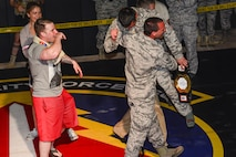 Members from the 35th Security Forces Squadron congratulate Airman Sergio Miranda, a 35th SFS entry controller, after winning the belt and title of the 2017 Combatives Champion during the second annual Security Forces Advanced Combat Skills Assessment held at the Security Forces Regional Training Center at Andersen Air Force Base, Guam, June 8, 2017. More than 100 Airmen and Soldiers throughout the U.S. Pacific Command's area of responsibility gathered to compete in five different categories: weapons, tactics, combat fitness, mental and physical challenge and military working dog handling. (U.S. Air Force photo by Airman 1st Class Christopher Quail)