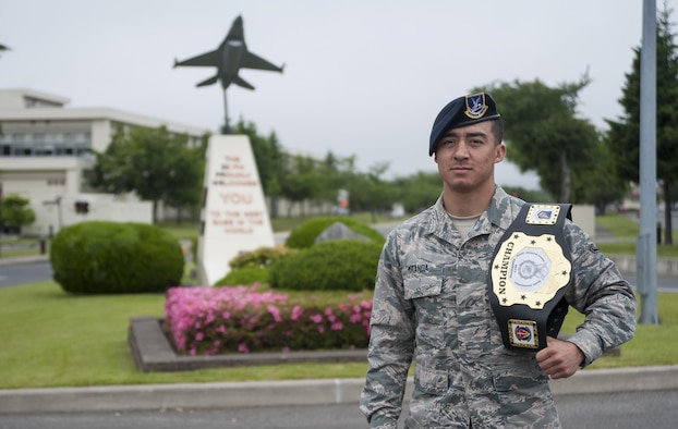 U.S. Air Force Airman Sergio Miranda, a 35th Security Forces Squadron entry controller, pauses for a photo at Misawa Air Base, Japan, June 16, 2017. Miranda won the belt and title of the 2017 Combatives Champion of the second annual Security Forces Advanced Combat Skills Assessment held at the Security Forces Regional Training Center at Andersen Air Force Base, Guam, June 4 to 9. The combative portion was the only individual event of the competition. (U.S. Air Force photo by Staff Sgt. Melanie Hutto)