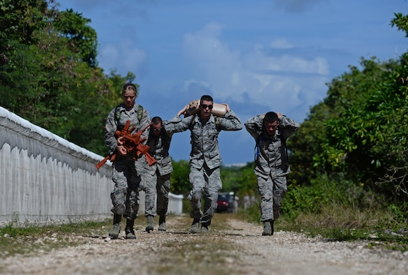 Members from the 35th Security Forces Squadron carry miscellaneous items during the second annual Security Forces Advanced Combat Skills Assessment held at the Security Forces Regional Training Center at Andersen Air Force Base, Guam, June 6, 2017. More than 100 Airmen and Soldiers throughout the U.S. Pacific Command competed in five categories including weapons, tactics, combat fitness, a mental and physical challenge and military working dogs. Each station conducted evaluations based on time to determine the best marksmen and combat tactics teams in the Pacific Air Forces security forces. The 35th SFS became the advanced Combat Skills champions. (U.S. Air Force photo by Airman 1st Class Gerald R. Willis)