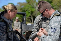 U.S. Airmen with the 35th Security Forces Squadron, Misawa Air Base, Japan, assemble an M240 machine gun during the second annual Security Forces Combat Skills Assessment June 6, 2017 at Andersen Air Force Base, Guam. The mental and physical challenge portion tested basic combat skills and knowledge of competitors at different stations along an obstacle course through the jungle. (U.S. Air Force photo by Airman 1st Class Gerald R. Willis)