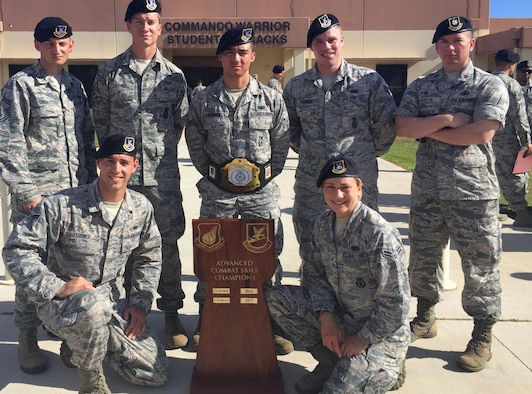 The 35 Security Forces Squadron of the firing team members pause for a photo with the Advanced Combat Skills trophy following the conclusion of the second annual Defenders Challenge held at the Security Forces Regional Training Center at Andersen Air Force Base, Guam, on June 9, 2017. The competition broke down in five categories including weapons, tactics, combat fitness, mental and physical challenge and military working dogs. At each station the were conducted based on time. (Courtesy photo)