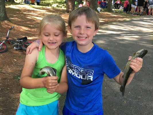 Several kids hold the trout they caught during the 20th Annual Kids Fishing Rodeo June 10, 2017 at the Dale Hollow National Fish Hatchery.