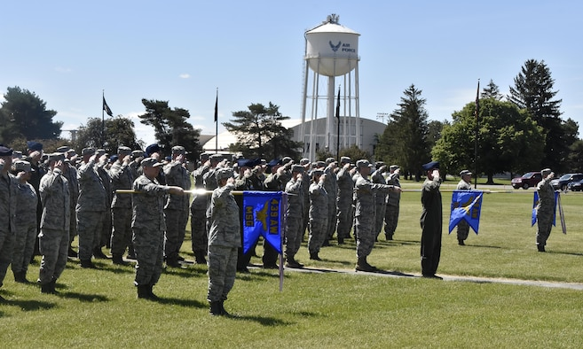 Westover Airmen salute during the national anthem June 4 at the change of command ceremony on the base ellipse. Brig. Gen. Jay Jensen relinquised command of the wing to Col. D. Scott Durham.