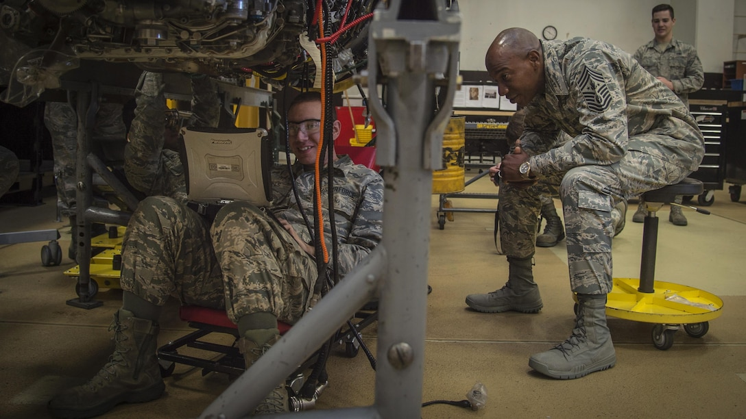 Chief Master Sgt. of the Air Force Kaleth O. Wright speaks with Airman 1st Class Jeremy Daniels, a 35th Maintenance Squadron aerospace propulsion journeyman, during his Pacific Air Forces' immersion tour at Misawa Air Base, Japan, June 9, 2017. Wright toured various work centers, focusing his visit on innovative Airmen who contribute to the overall growth of the Air Force. He also sat with Airmen and NCOs to learn more about their concerns about the Air Force. (U.S. Air Force photo/Senior Airman Deana Heitzman)