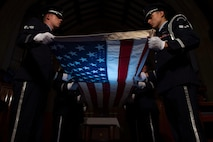 Air Force service members, assigned to the base Honor Guard, perform a flag folding ceremony at Joint Base Langley-Eustis, Va., June 12, 2017. The flag folding ceremony is a time honored tradition that is used during Memorial Day and Veterans Day ceremonies, as well as retirements from the Armed Forces. (U.S. Air Force photo/Staff Sgt. Carlin Leslie)