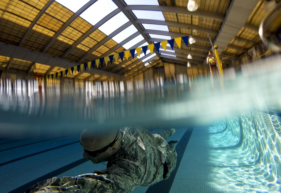 Tech. Sgt. David Troche from the New Jersey Air National Guard's 108th Security Forces Squadron swims the 100 meter challenge during a German Armed Forces Badge for Military Proficiency test at Joint Base McGuire-Dix-Lakehurst, N.J., June 13, 2017. The test included a 1x10-meter sprint, flex arm hang, 1,000 meter run, 100 meter swim in military uniform, marksmanship, and a timed foot march. (U.S. Air National Guard photo/Master Sgt. Matt Hecht)