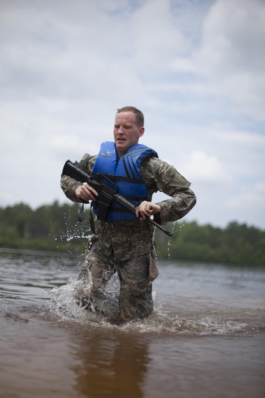 Ssg. David Rosa a psychological operations specialist representing the United States Army Civil Affairs and Psychological Operations Command (Airborne), finishes a 300 meter swim during a mystery event, at the 2017 U.S. Army Reserve Best Warrior Competition at Fort Bragg, N.C. June 15. This year's Best Warrior Competition will determine the top noncommissioned officer and junior enlisted Soldier who will represent the U.S. Army Reserve in the Department of the Army Best Warrior Competition later this year at Fort A.P. Vill, Va. (U.S. Army Reserve photo by Spc. Jesse L. Artis Jr.) (Released)