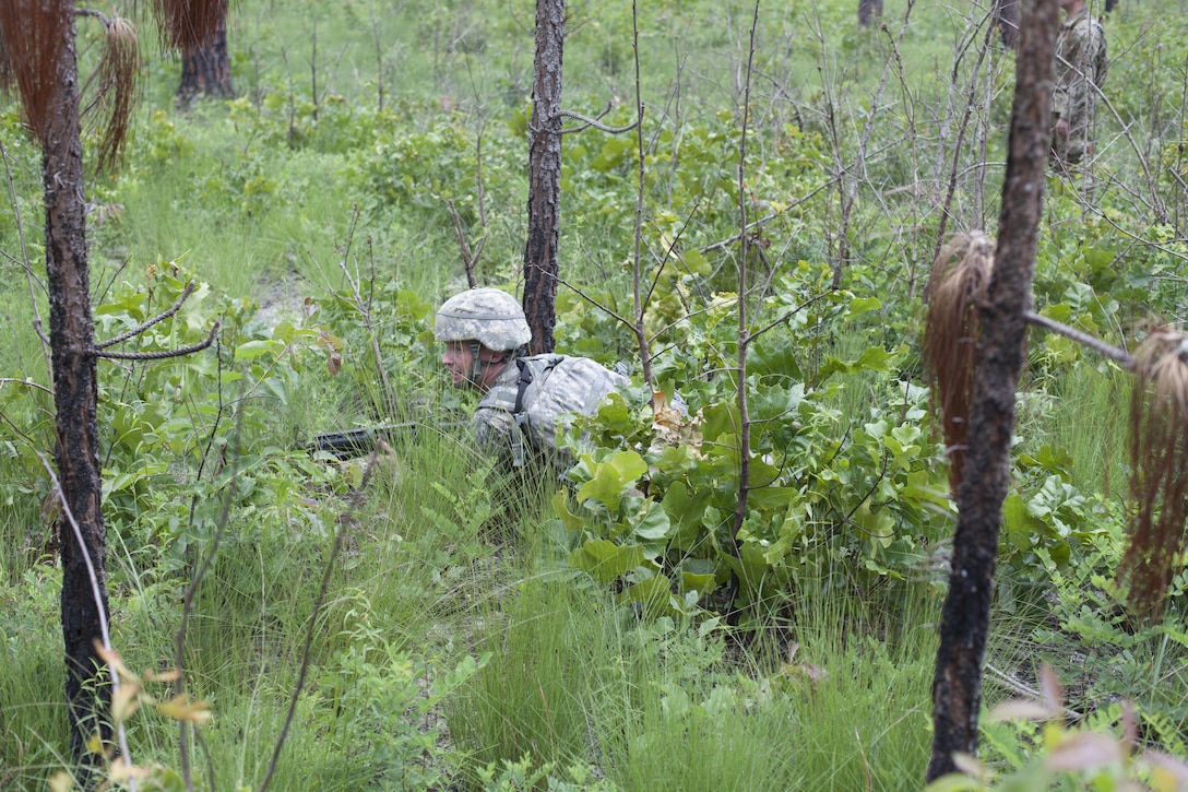 Ssg. David Rosa a psychological operations specialist representing the United States Army Civil Affairs and Psychological Operations Command (Airborne), takes cover as he engage in simulated enemy fire, during a mystery event, at the 2017 U.S. Army Reserve Best Warrior Competition at Fort Bragg, N.C. June 15. This year's Best Warrior Competition will determine the top noncommissioned officer and junior enlisted Soldier who will represent the U.S. Army Reserve in the Department of the Army Best Warrior Competition later this year at Fort A.P. Vill, Va. (U.S. Army Reserve photo by Spc. Jesse L. Artis Jr.) (Released)