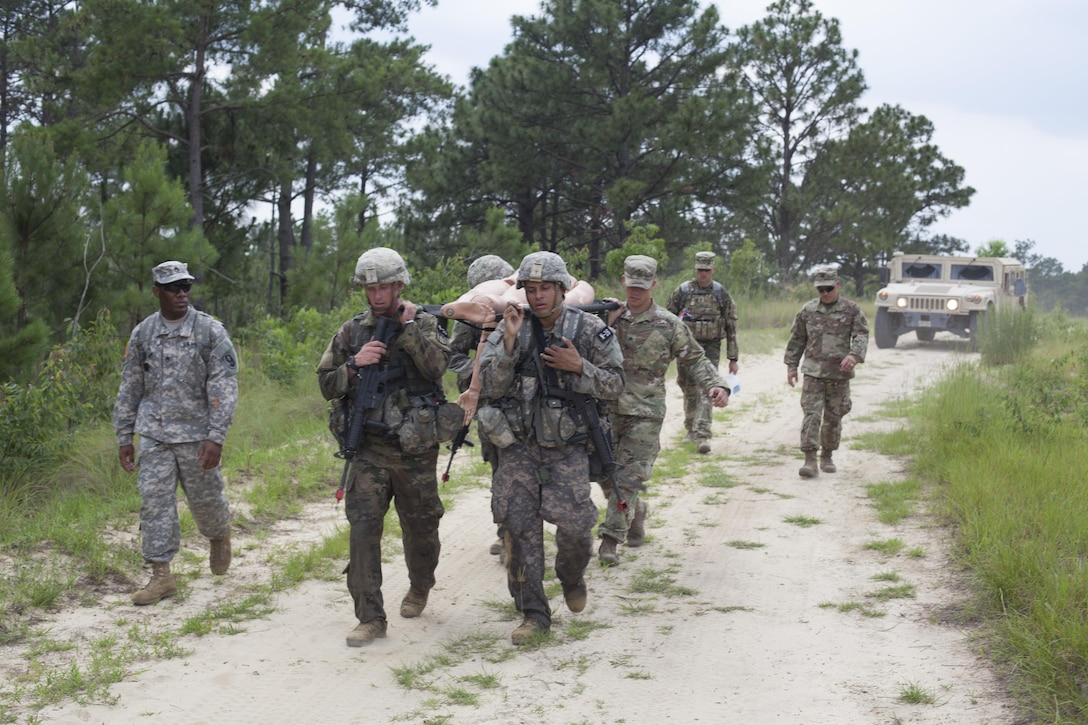 Four Warriors carry a simulated casualty during a mystery event at the 2017 U.S. Army Reserve Best Warrior Competition at Fort Bragg, N.C. June 15. This year's Best Warrior Competition will determine the top noncommissioned officer and junior enlisted Soldier who will represent the U.S. Army Reserve in the Department of the Army Best Warrior Competition later this year at Fort A.P. Vill, Va. (U.S. Army Reserve photo by Spc. Jesse L. Artis Jr.) (Released)