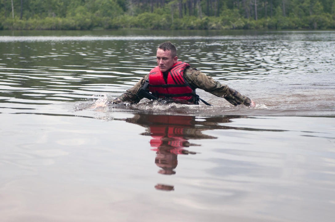Sgt. 1st Class Andrew England, a combat engineer specialist representing the 416th Theater Engineer Command, finishes up his 300-meter swim during the mystery event Day 4 at the 2017 U.S. Army Reserve Best Warrior Competition at Fort Bragg, N.C. June 15. This year's Best Warrior Competition will determine the top noncommissioned officer and junior enlisted Soldier who will represent the U.S. Army Reserve in the Department of the Army Best Warrior Competition later this year at Fort A.P. Hill, Va. (U.S. Army Reserve photo by Spc. Noel Williams) (Released)