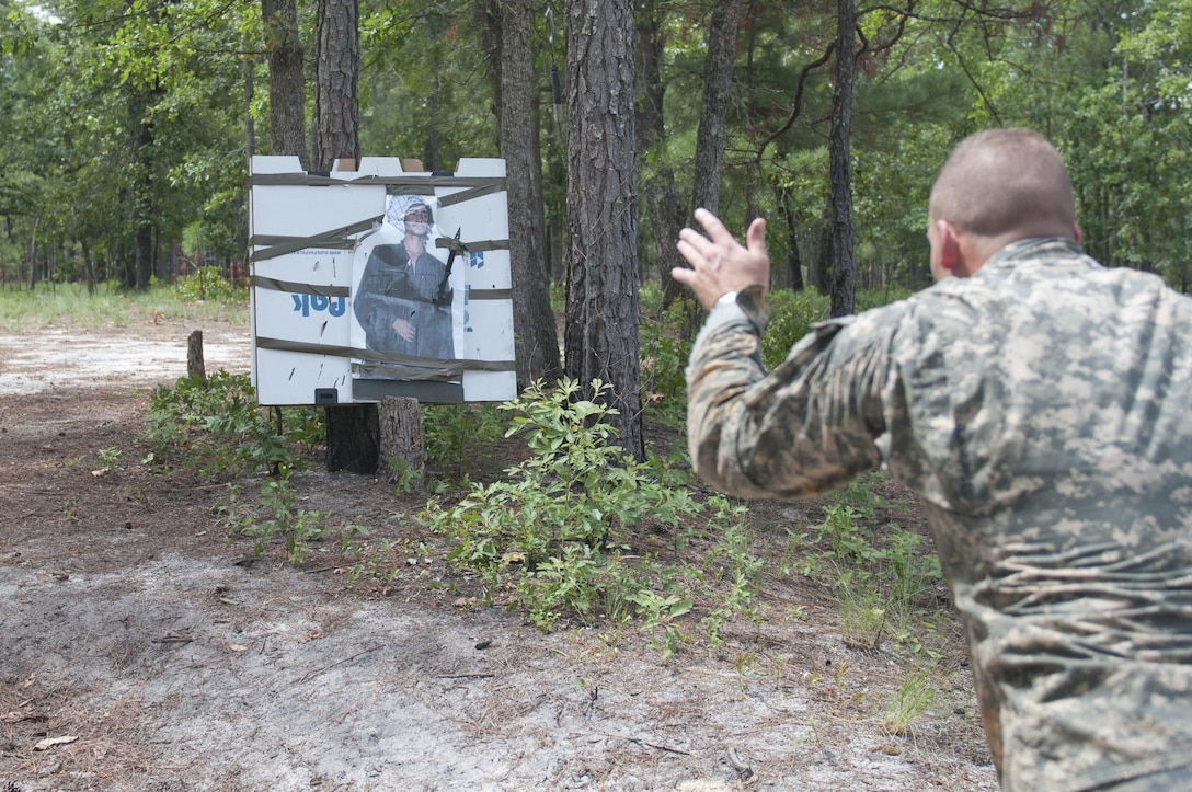 A Warrior throws a tomahawk at an enemy cut-out during Mystery Event Day 4 at the 2017 U.S. Army Reserve Best Warrior Competition at Fort Bragg, N.C. June 15. This year's Best Warrior Competition will determine the top noncommissioned officer and junior enlisted Soldier who will represent the U.S. Army Reserve in the Department of the Army Best Warrior Competition later this year at Fort A.P. Hill, Va. (U.S. Army Reserve photo by Sgt. Jennifer Shick) (Released)