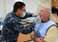 Navy Petty Officer 3rd Class Ernest Manzon, a dental assistant from the Expeditionary Medical Force of Camp Pendleton, Calif., takes x-rays of a patient during Innovative Readiness Training at Mountain Home, Ark., June 12, 2017. The IRT program allows active-duty, guard and reserve members to volunteer for real-world training opportunities through engineering, veterinarian, medical, and construction projects that benefit the sometimes-forgotten citizens of American communities in need. (U.S. Air National Guard photo by Staff Sgt. Carlynne DeVine)