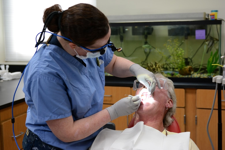 Navy Lt. Juliana Fila, a dentist from Naval Hospital Bremerton, Wash., cleans a patient's teeth during Innovative Readiness Training at Mountain Home, Ark., June 12, 2017. The IRT program allows active-duty, guard and reserve members to volunteer for real-world training opportunities through engineering, veterinarian, medical, and construction projects that benefit the sometimes-forgotten citizens of American communities in need. (U.S. Air National Guard photo by Staff Sgt. Carlynne DeVine)