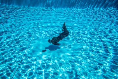 A U.S. Marine with 1st Marine Logistics group participates in the water survival advanced course on Camp Pendleton, Calif., June 14, 2017. The purpose of the water survival course is to strengthen the individual Marine's self-preservation and rescue skills in water. 1st MLG is home to multiple military occupations that work together to provide support to each element of the 1st Marine Expeditionary Force through logistics beyond the capabilities of the supported units. (U.S. Marine Corps photo by Lance Cpl. Adam Dublinske)