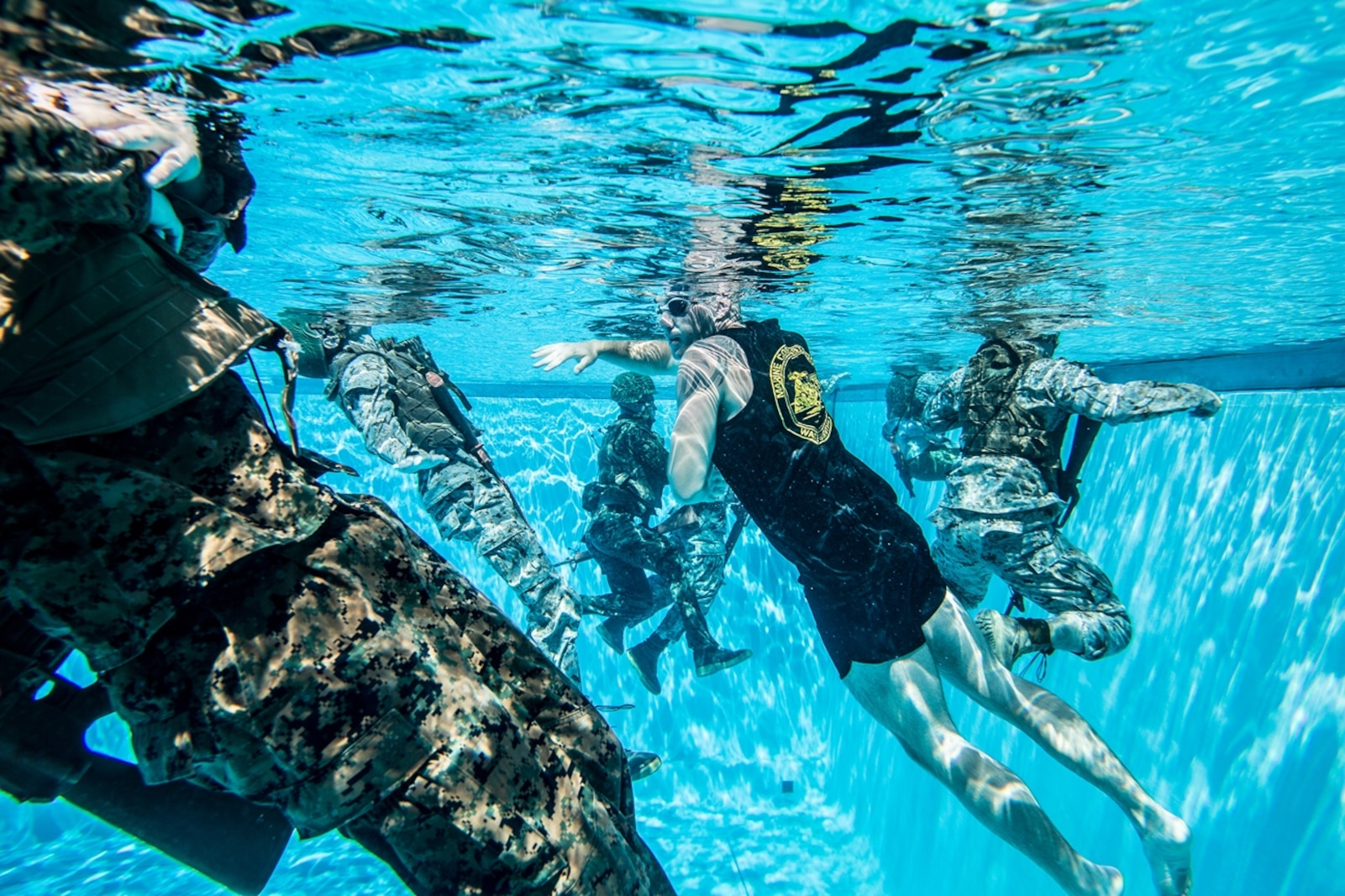 U.S. Marine Cpl. Daniel Ramech, a Marine Corps Instructor of Water Survival with Headquarters Regiment, 1st Marine Logistics Group, observes a water survival advanced course on Camp Pendleton, Calif., June 14, 2017. MCIWS teaches Marines how to improve their abilities in surviving and saving others in water. 1st MLG is home to multiple military occupations that work together to provide support to each element of the 1st Marine Expeditionary Force through logistics beyond the capabilities of the supported units. (U.S. Marine Corps photo by Sgt. Rodion Zabolotiny)