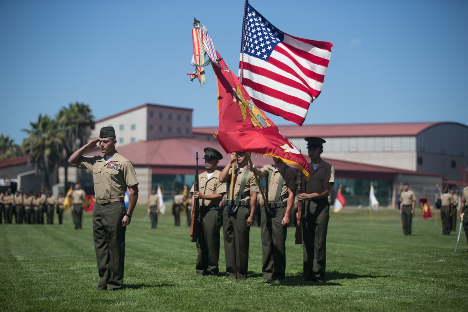 U.S. Marine Col. Phillip N. Frietze renders honors during the national anthem at the Headquarters Regiment, 1st Marine Logistics Group, change of command ceremony on Camp Pendleton, Calif., June 15, 2017. The ceremony included marching of the colors, passing of the regimental colors, presenting Col. Frietze his away and closing remarks from the oncoming and off going personnel as well as the 1st MLG Commanding General, Brig. Gen. David A. Ottignon. (U.S. Marine Corps photo by Lance Cpl. Timothy Shoemaker)