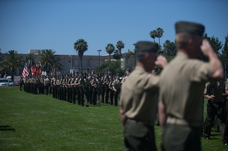 U.S. Marines with 1st Marine Logistics Group perform a pass in review in front of Cols. Phillip N. Frietze (left) and James R. Hensein (right) during the Headquarters Regiment, 1st Marine Logistics Group, change of command ceremony on Camp Pendleton, Calif., June 15, 2017. The ceremony included marching of the colors, passing of the regimental colors, presenting Col. Frietze his away and closing remarks from the oncoming and off going personnel as well as the 1st MLG Commanding General, Brig. Gen. David A. Ottignon. (U.S. Marine Corps photo by Lance Cpl. Timothy Shoemaker)