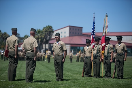 U.S. Marine Col. Phillip N. Frietze prepares to receive his award during the Headquarters Regiment, 1st Marine Logistics Group, change of command ceremony on Camp Pendleton, Calif., June 15, 2017. The ceremony included marching of the colors, passing of the regimental colors, presenting Col. Frietze his away and closing remarks from the oncoming and off going personnel as well as the 1st MLG Commanding General, Brig. Gen. David A. Ottignon. (U.S. Marine Corps photo by Lance Cpl. Timothy Shoemaker)
