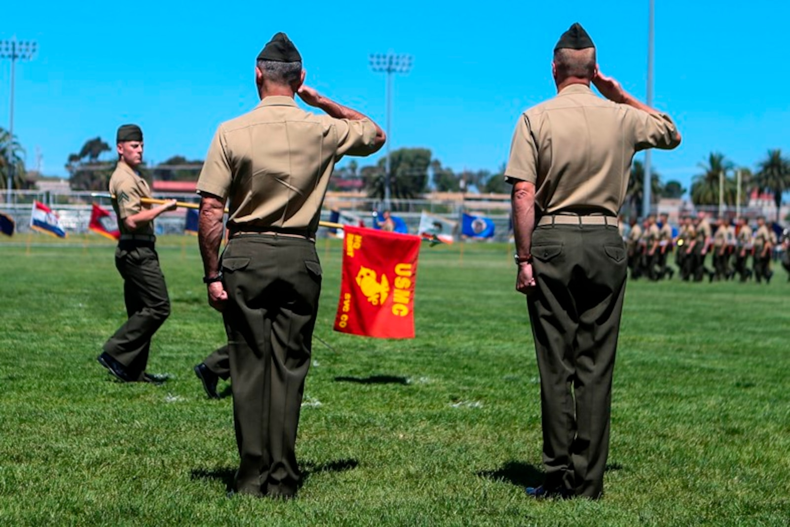 U.S. Marine Cols. Phillip N. Frietze (left) and James R. Hensien (right) return a salute during the pass in review at the 1st Marine Logistics Group Headquarters Regiment Change of Command on Camp Pendleton, Calif., June 15, 2017. The ceremony included marching of the colors, passing of the regimental colors, presenting Frietze his award and closing remarks from the oncoming and off going personnel as well as the 1st MLG Commanding General, Brig. Gen. David A. Ottignon. (U.S. Marine Corps photo by Lance Cpl. Joseph Sorci)
