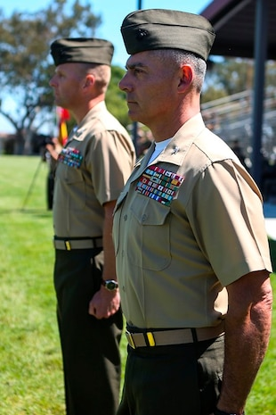 U.S. Marine Cols. Phillip N. Frietze (right) and James R. Hensien (left) stand ready to inspect the unit during the pass in review at the 1st Marine Logistics Group Headquarters Regiment Change of Command on Camp Pendleton, Calif., June 15, 2017. The ceremony included marching of the colors, passing of the regimental colors, presenting Frietze his award and closing remarks from the oncoming and off going personnel as well as the 1st MLG Commanding General, Brig. Gen. David A. Ottignon. (U.S. Marine Corps photo by Lance Cpl. Joseph Sorci)