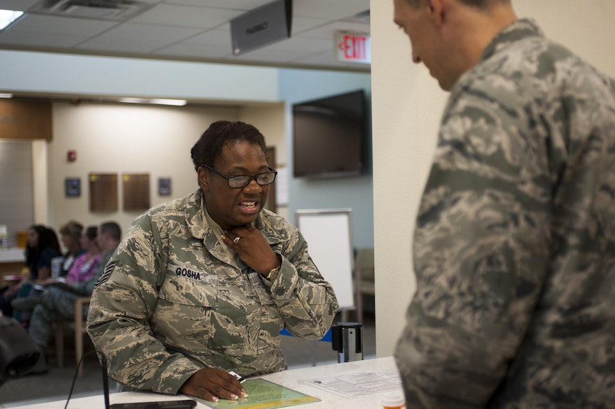 U.S. Air Force Capt. Brian Welch, 17th Medical Support Squadron pharmacist, assists Tech. Sgt. Vanessa Gosha, 17th Medical Support Squadron pharmacy technician, with her medical treatments at the Ross Clinic on Goodfellow Air Force Base, Texas, June 15, 2017. Welch became interested in pharmacy while in college. (U.S. Air Force photo by Senior Airman Scott Jackson/released)