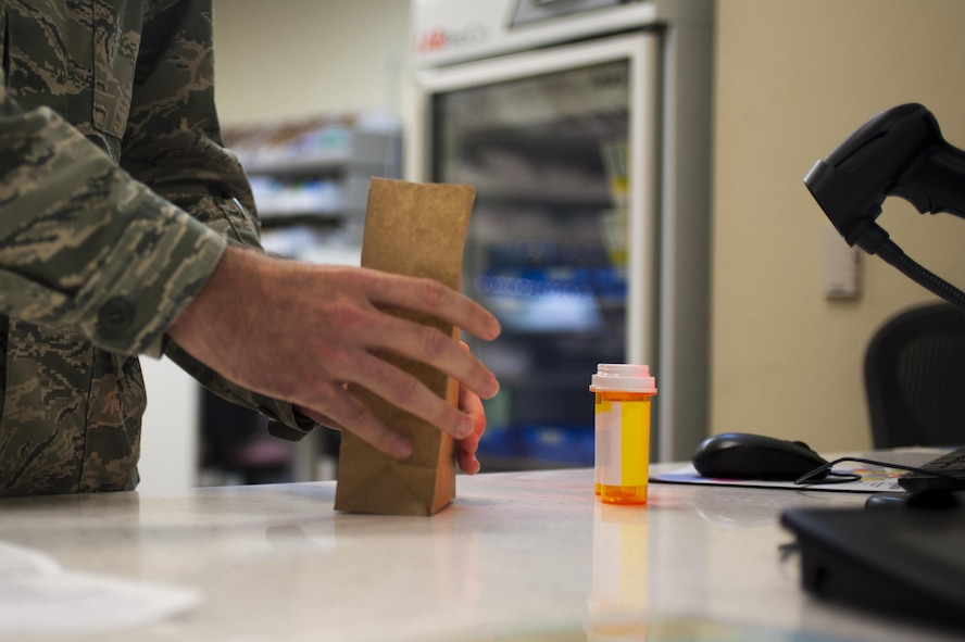 U.S. Air Force Capt. Brian Welch, 17th Medical Support Squadron pharmacist, prepares a prescription at the Ross Clinic on Goodfellow Air Force Base, Texas, June 15, 2017. Welch became interested in pharmacy while working as a cashier and then pharmacy technician in college. (U.S. Air Force photo by Senior Airman Scott Jackson/released)