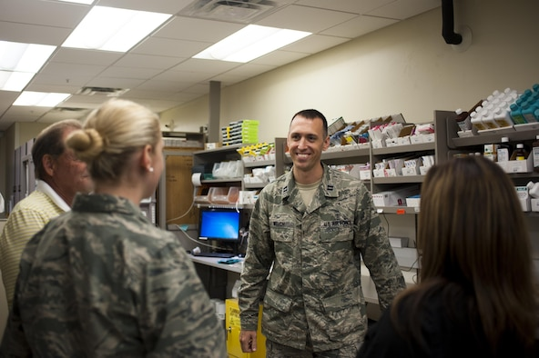 U.S. Air Force Capt. Brian Welch, 17th Medical Support Squadron pharmacist, talks to the pharmacy staff at the Ross Clinic on Goodfellow Air Force Base, Texas, June 15, 2017. Welch was nominated by the Pharmacist Times magazine for the Rising Star award. (U.S. Air Force photo by Senior Airman Scott Jackson/released)