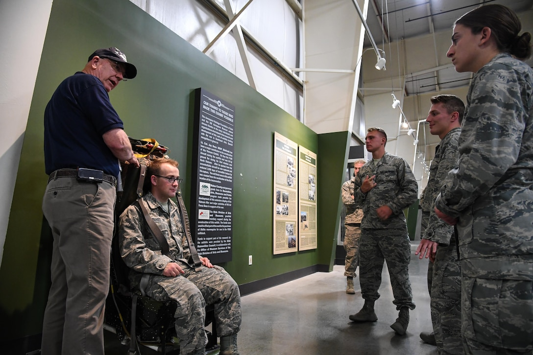 Volunteer docent Christopher Black speaks to U.S. Air Force Academy Cadets during a tour of the Hill Air Force Base Aerospace Museum, June 9, 2017. Ops AF is as a requirement for graduation and Hill AFB is one of the 60 continental United States bases working with the Academy to make this program possible. (U.S. Air Force photo/R. Nial Bradshaw)