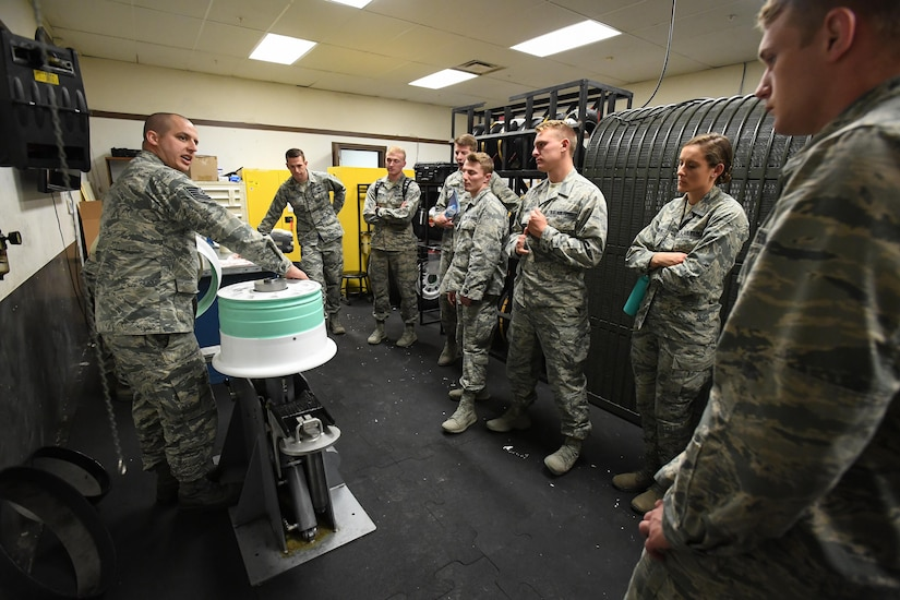 Tech. Sgt. Robert Pulley, 388th Maintenance Squadron, speaks to U.S. Air Force Academy Cadets during their tour of the 388th MXS Wheel Shop, Hill Air Force Base, Utah, June 14, 2017. Future Air Force officers visited Hill AFB as part of an annual program that introduces them to the experiences they'll likely have at an operational base after graduation. (U.S. Air Force photo/R. Nial Bradshaw)