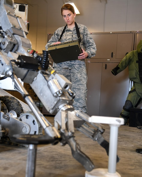 U.S. Air Force Academy Cadet Raina Cerniglia operates a robot while touring the 775th Explosive Ordnance Disposal Compound, June 8, at Hill Air Force Base, Utah. Ops AF benefits cadets, who will soon begin deciding on career paths, by providing a look at some of the many career fields available to an Air Force officer. (U.S. Air Force photo/R. Nial Bradshaw)