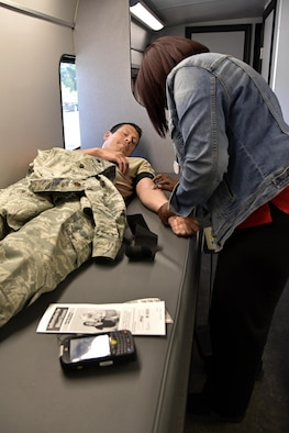 Air Force Major Tim Keegan, budget officer assigned to the 175th Comptroller Flight, participates in a blood drive June 15, 2017 at Warfield Air National Guard Base, Middle River, Md. Keegan was donating blood on base for the first time and has donated elsewhere several times before. (U.S. Air National Guard photo by Airman Sarah M. McClanahan)