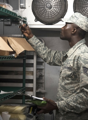 U.S. Air Force Staff Sgt. Cornelius Bransah, the NCO in charge of food safety and sanitation assigned to the 6th Aerospace Medical Squadron, checks a thermometer inside a walk-in refrigerator at MacDill Air Force Base, Fla., June 13, 2017. Bransah routinely inspects more than 50 facilities on MacDill, ensuring the food and the facilities are safe for the public. (U.S. Air Force photo by Airman 1st Class Adam R. Shanks)
