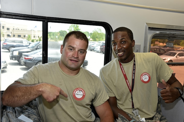 (From left) Staff Sgt. Rhyse Singleton, aerospace ground equipment technician in the 175th Maintenance Squadron, and Technical Sgt. Carl Washington, NCO in charge of communications focal point in the 175th Communications Squadron, pose for a photo June 15, 2017 while donating blood at Warfield Air National Guard Base, Middle River, Md. Both service members have donated multiple times on base through the American Red Cross. (U.S. Air National Guard photo by Airman Sarah M. McClanahan)
