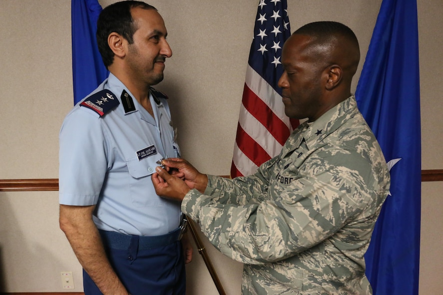 Royal Saudi Air Force Senior Country Liaison Officer, Bader Alotaibi, is promoted to Colonel as Brig. Gen. Ronald Jolly, 82nd Training Wing commander, pins on his rank, June 14, 2017. RSAF students train at Sheppard Air Force Base in a variety of F-15 Strike Eagle maintenance courses. (U.S. Air Force courtesy photo)