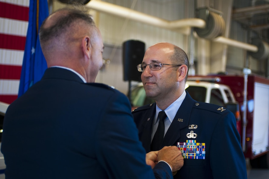 U.S. Air Force Col. Christopher Harris, 17th Mission Support Group Commander, receives the meritorious servicemedal from Col. Michael Downs, 17th Training Wing Commander, at the Logistics and Readiness High Bay on Goodfellow Air Force Base, Texas, June 16, 2017. Harris served as 17 MSG commander from 2014 to 2016. (U.S. Air Force photo by Senior Airman Scott Jackson/Released)