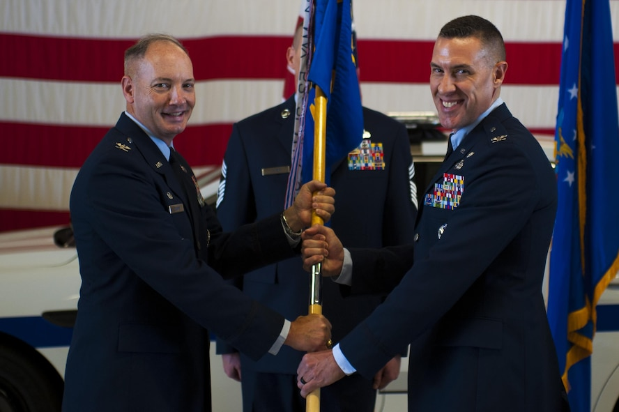 U.S. Air Force Col. Jason Beck, the new 17th Mission Support Group Commander, receives the guideon from Col. Michael Downs, 17th Training Wing Commander, during the 17th MSG Change of Command ceremony at the Logistics and Readiness High Bay on Goodfellow Air Force Base, Texas, June 16, 2017. Beck previously served the Branch Chief of Antiterrorism Plans and Programs at Headquarters United States Pacific Command. (U.S. Air Force photo by Senior Airman Scott Jackson/Released)