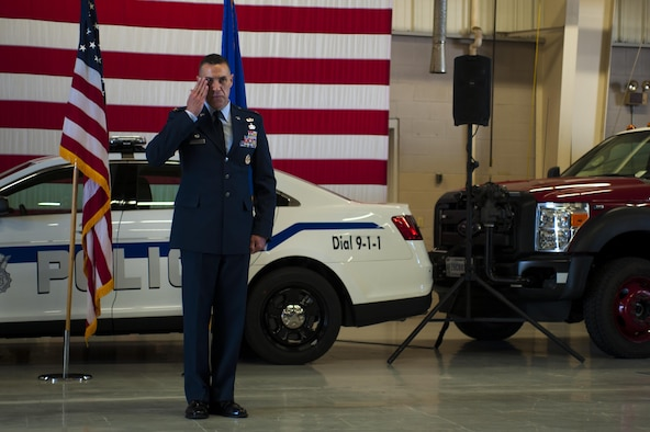 U.S. Air Force Col. Jason Beck, 17th Training Group Commander, salutes the group for the first time as commander at the Logistics and Readiness High Bay on Goodfellow Air Force Base, Texas, June 16, 2017. Beck previously served the Branch Chief of Antiterrorism Plans and Programs at Headquarters United States Pacific Command. (U.S. Air Force photo by Senior Airman Scott Jackson/Released)