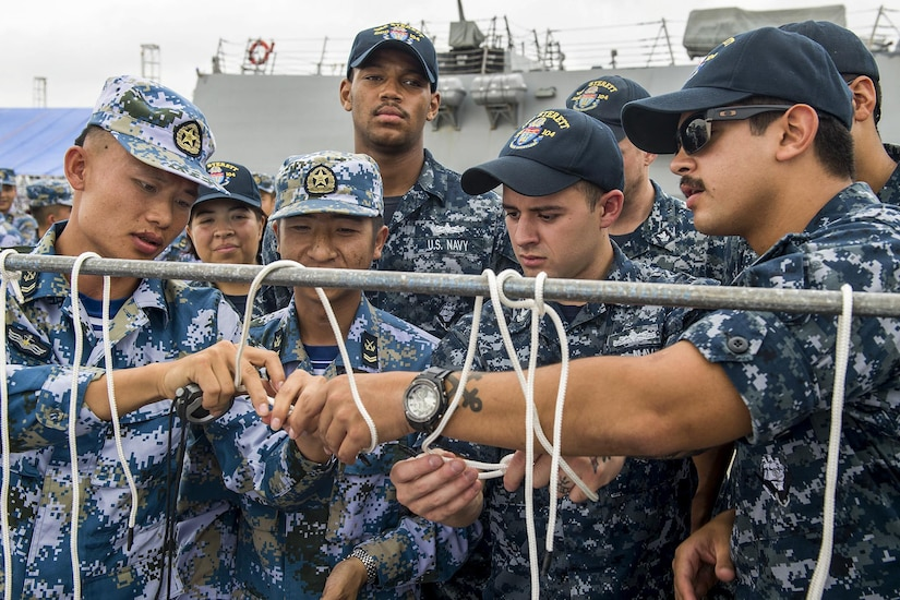 U.S. and Chinese sailors practice tying knots before a seamanship competition in Zhanjiang, China, June 14, 2017. The U.S. sailors are assigned to the USS Sterett, which is conducting a scheduled port visit to the city. Navy photo by Petty Officer 1st Class Byron C. Linder