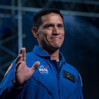 Army Maj. (Dr.) Francisco Rubio waves as he is introduced as one of 12 new astronaut candidates at NASA's Johnson Space Center in Houston, Texas, June 7, 2017. After completing two years of training, the new astronaut candidates could be assigned to research missions aboard the International Space Station, on launches from American soil aboard spacecraft built by commercial companies or on deep-space missions aboard NASA's new Orion spacecraft and Space Launch System rocket. NASA photo by Bill Ingalls